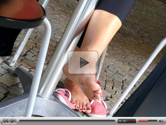 Candid red toenails feet and soles in