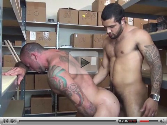 Muscular gays lovers in warehouse