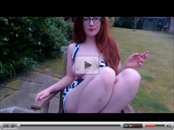 Busty Redhead smoking outside